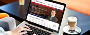 Gerstenfield attorney website on a laptop with coffee beverage
